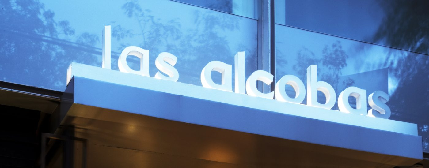 Las Alcobas front of hotel with sign