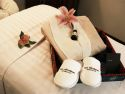 Up close image of slippers and robe on spa bed